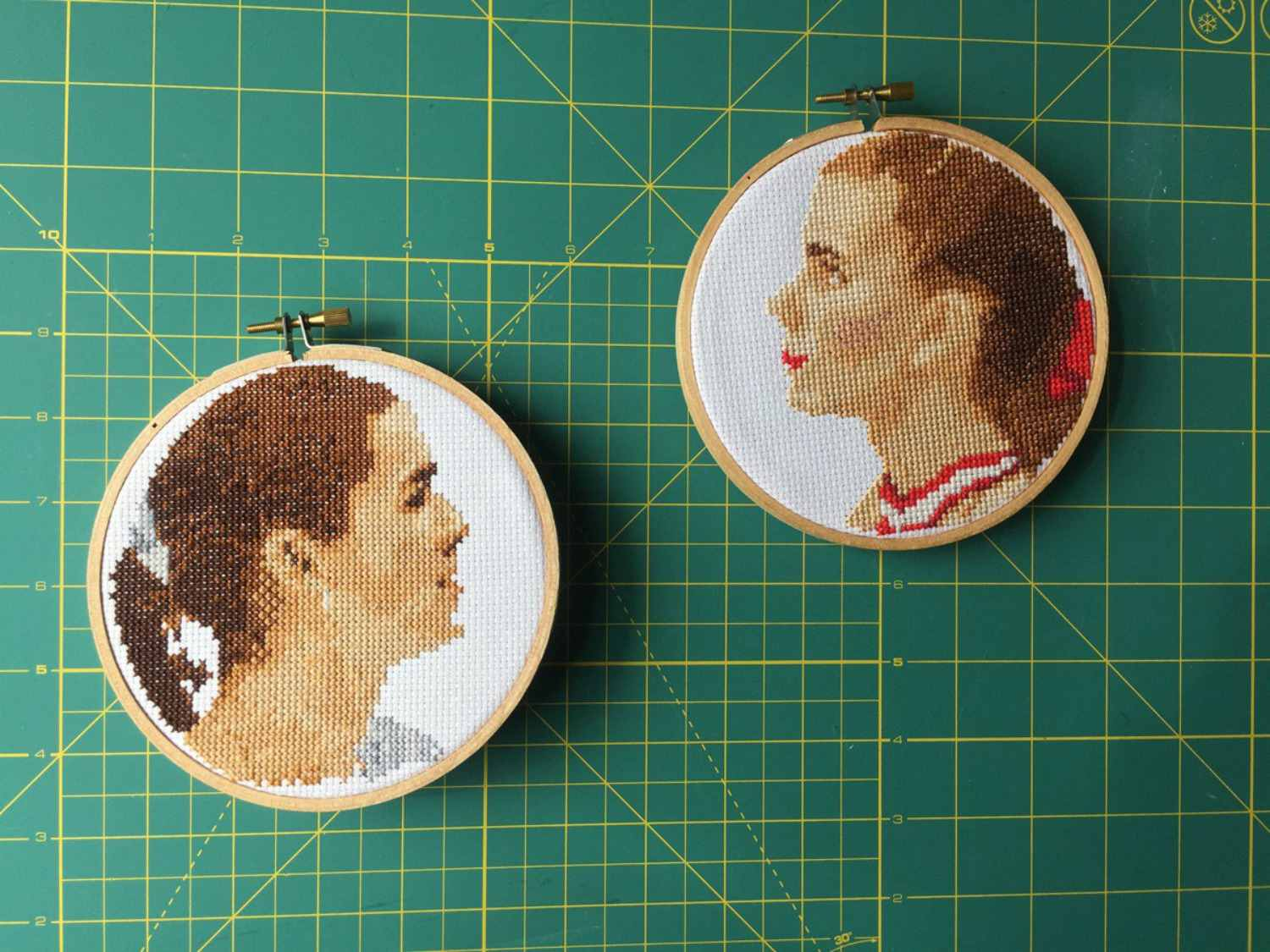 Cross-stitch faces in hoops