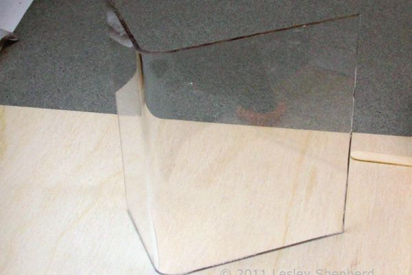 Neat, even gentle curve bend in sheet plastic made with a simple jig and an embossing heat tool.