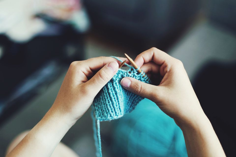 Person knitting a pattern.