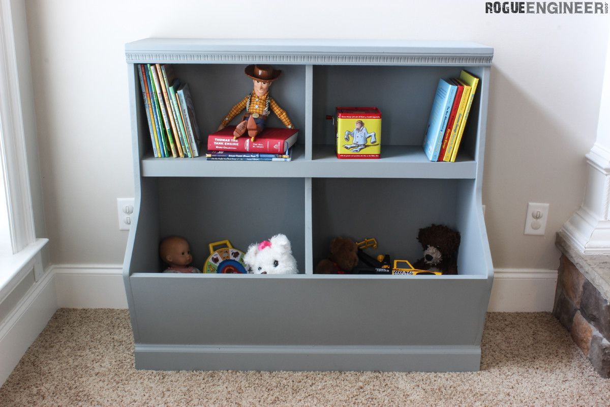 A wooden bookshelf and toy box filled with toys and books