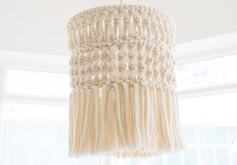 A macrame chandelier hanging from the ceiling
