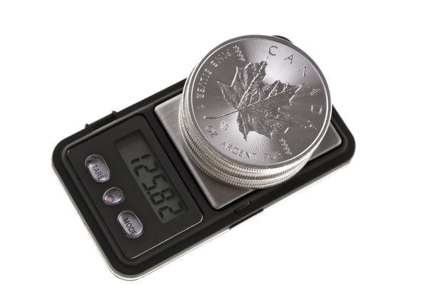 Silver bullion coins on a scale