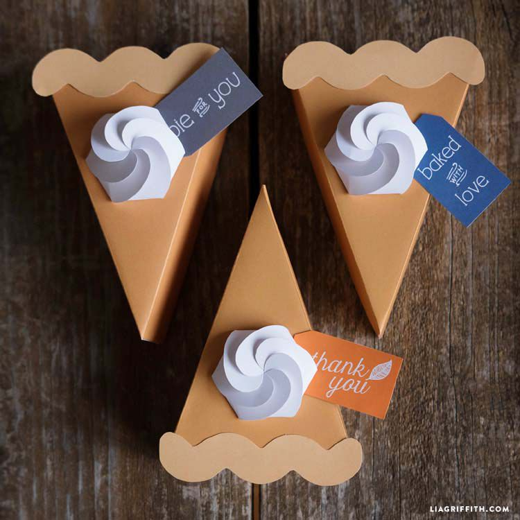 Three pumpkin pie slices made from paper