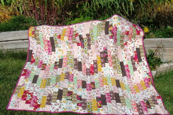 A colorful quilt outside