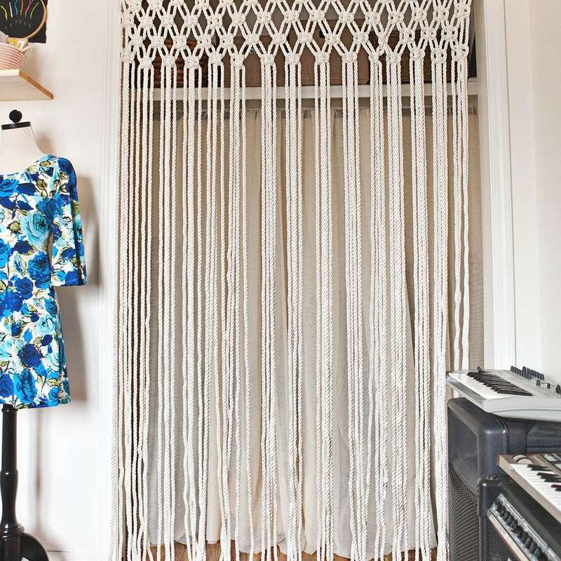 A macrame curtain in front of a closet