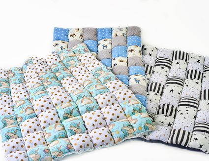 Bundle of colorful patchworked comforters with unicorn and stars design on white background - three pieces