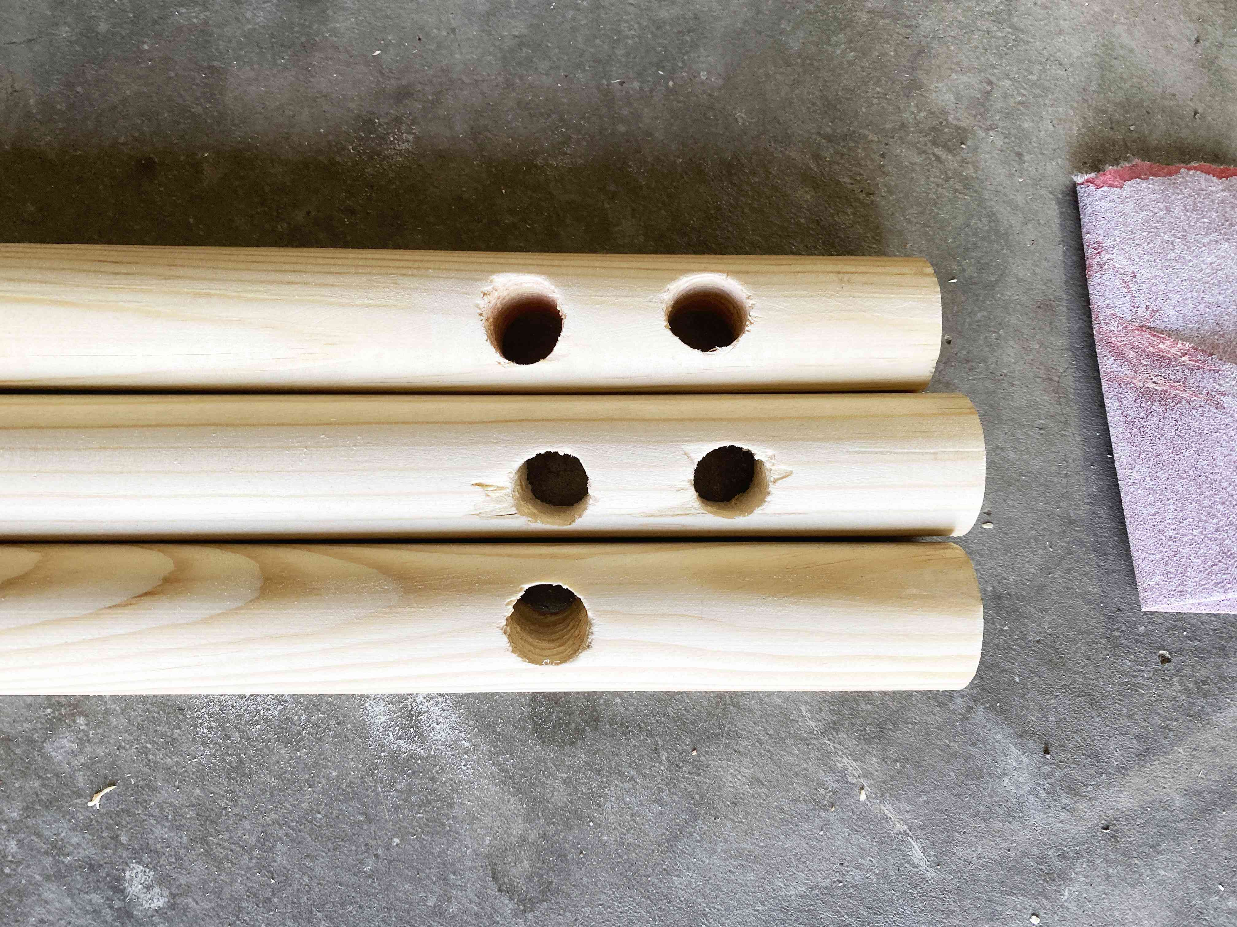 Dowel rods with holes drilled in them