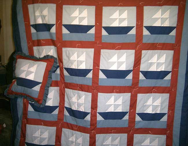 Baby quilt with 16 ship blocks and matching pillow.