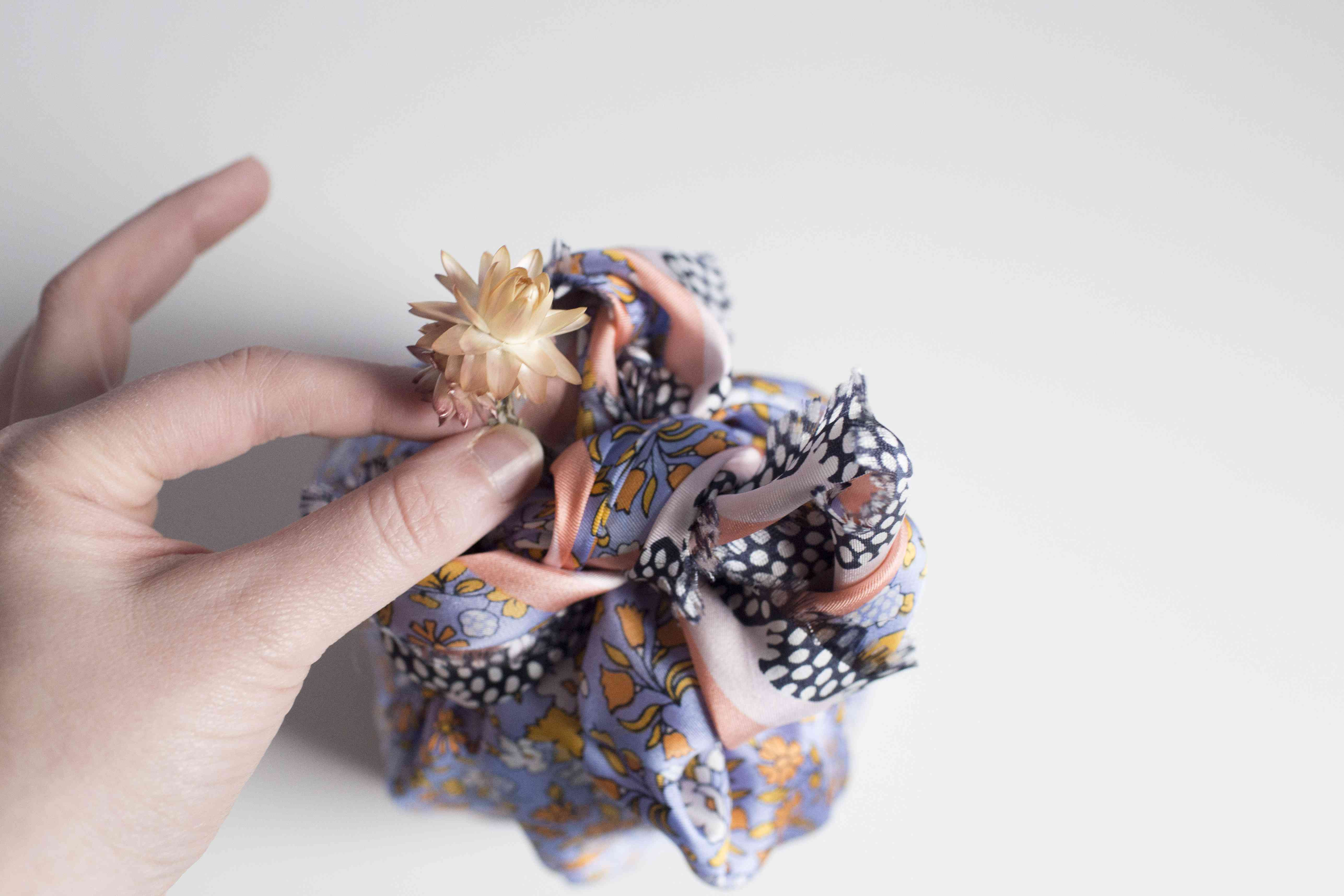 Fluff excess material in furoshiki