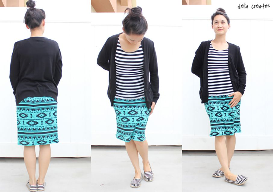 A woman wearing a blue and black skirt, striped shirt, and sweater