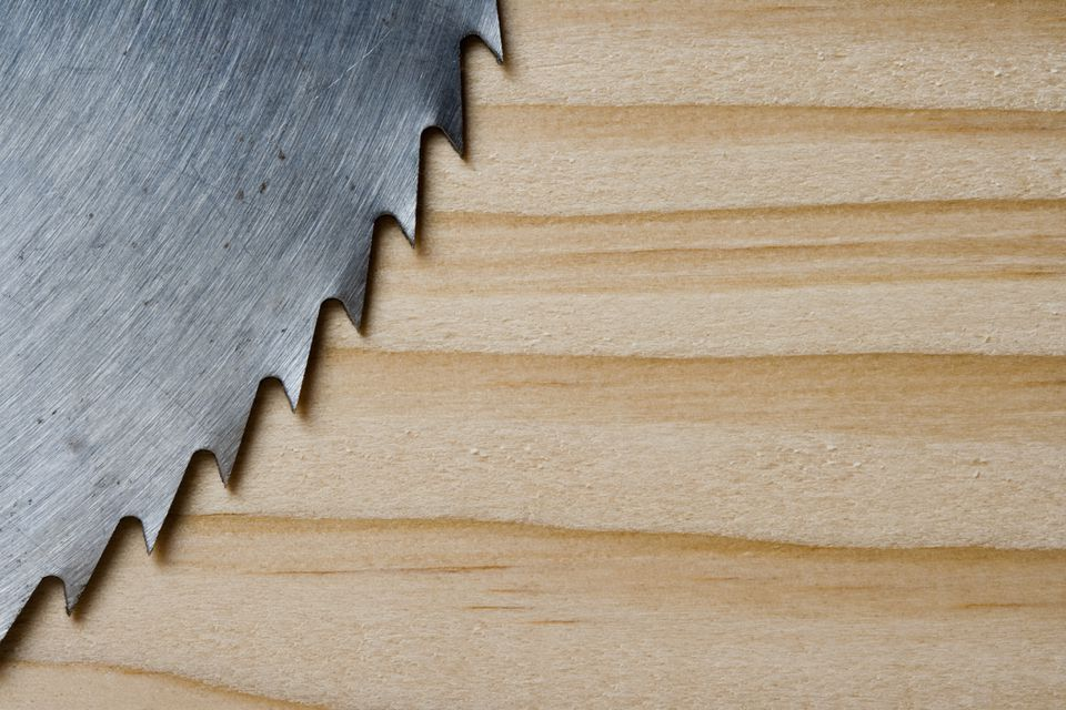 Close up of saw blade on wood