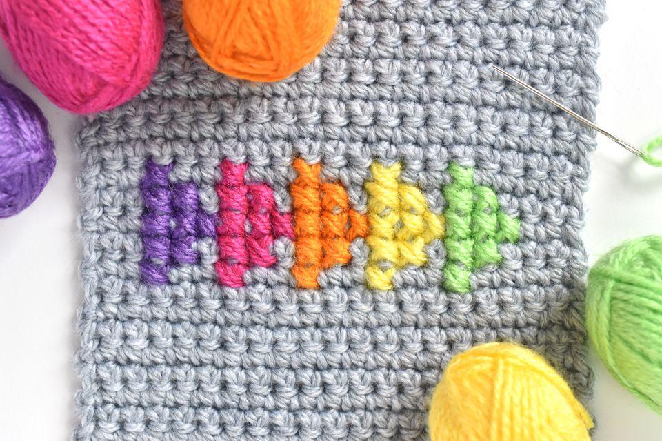 Cross stitch on a piece of crochet