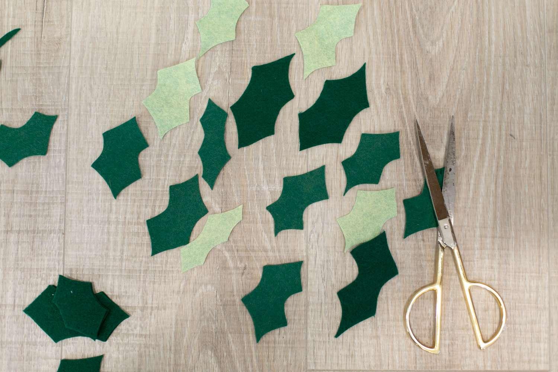 cut holly leaves from felt