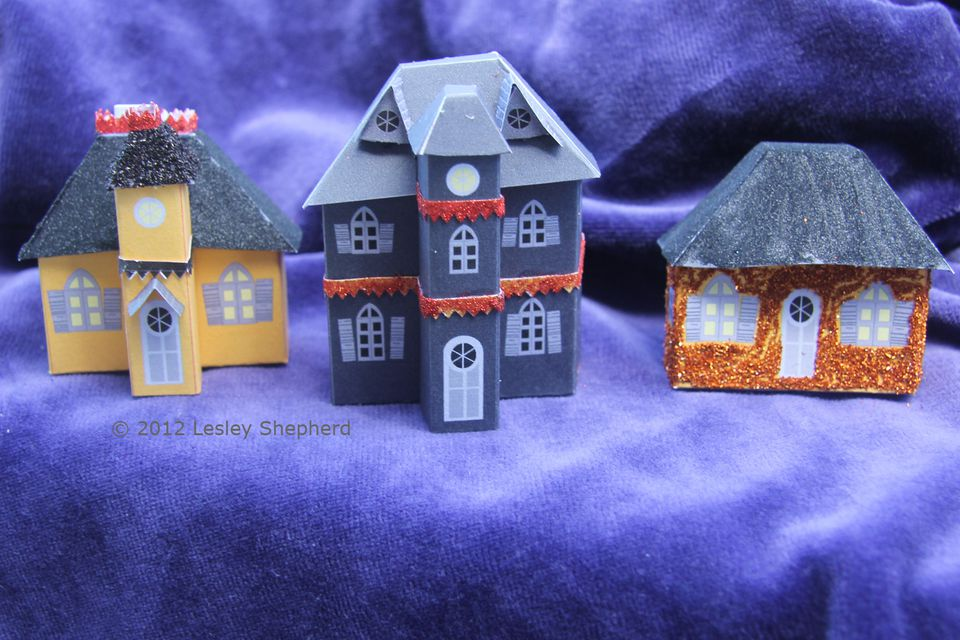 Three gothic style mansard roof miniature halloween glitter houses made using free printables.