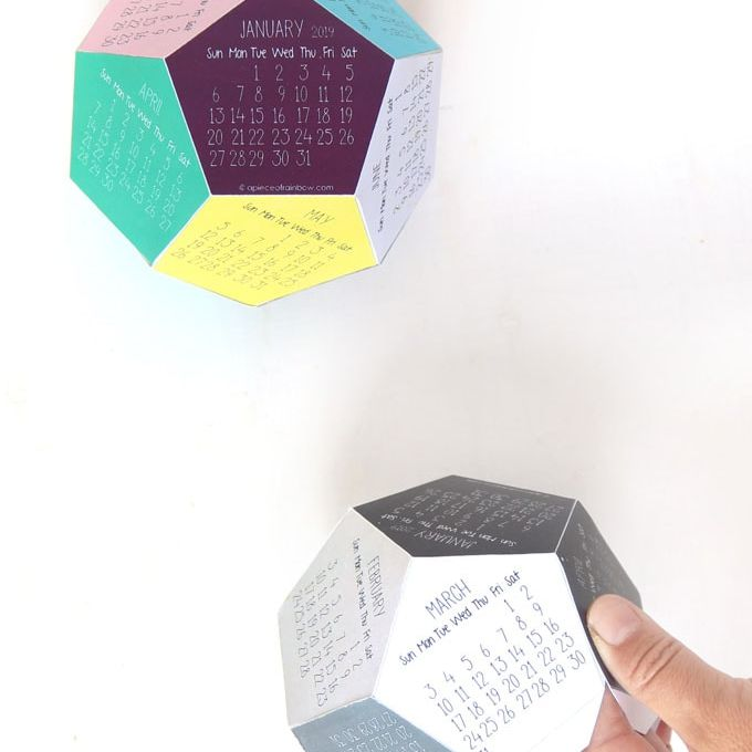 Two 3D calendars on a table