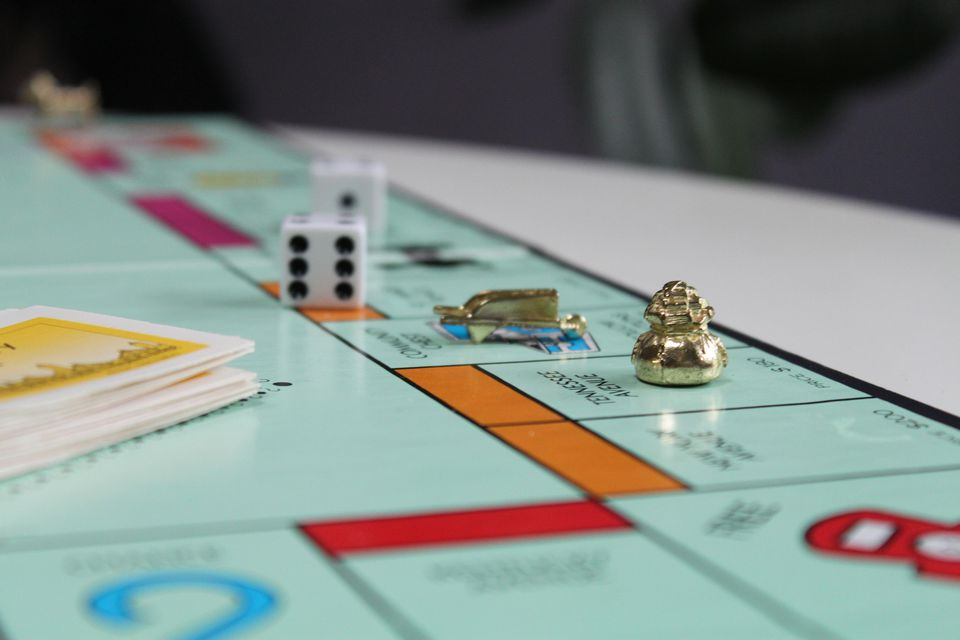 Monopoly game pieces on Community Chest and Tennessee Ave