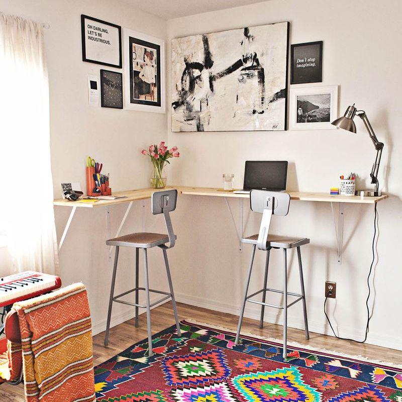 Standing desks in the corner of a room