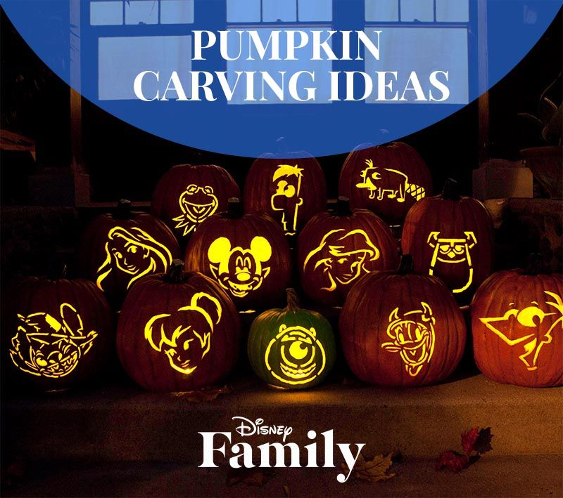 Picture of Disney pumpkin carvings lit up outside