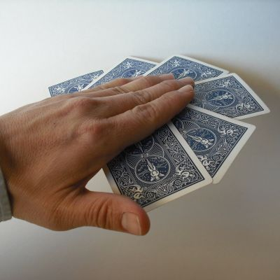 hand holding cards in mid-air