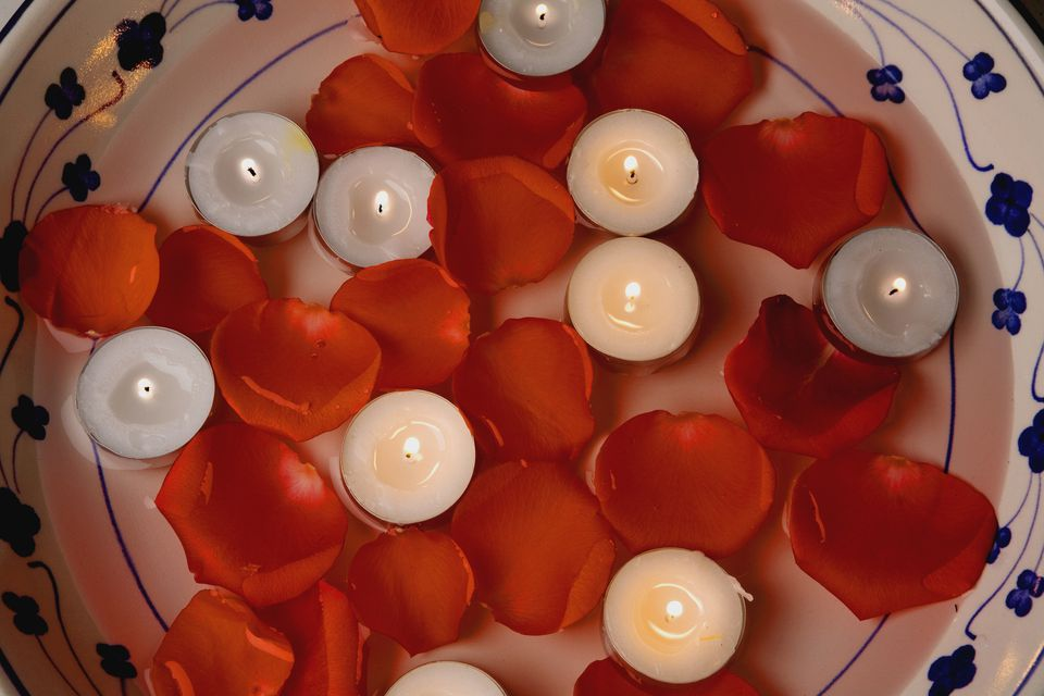 Floating candles with flower petals