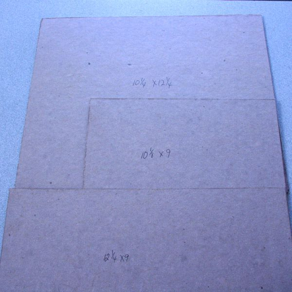 Pieces of book binding board cut ready to make a 1:12 scale dolls house room box.