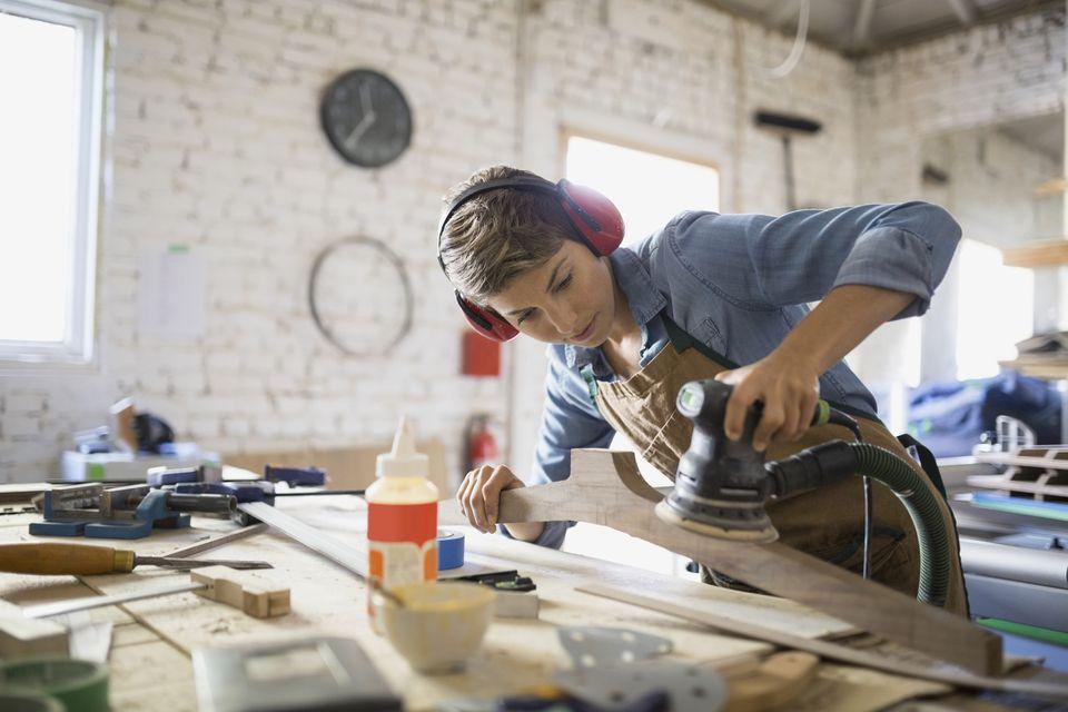A woman building a DIY bed