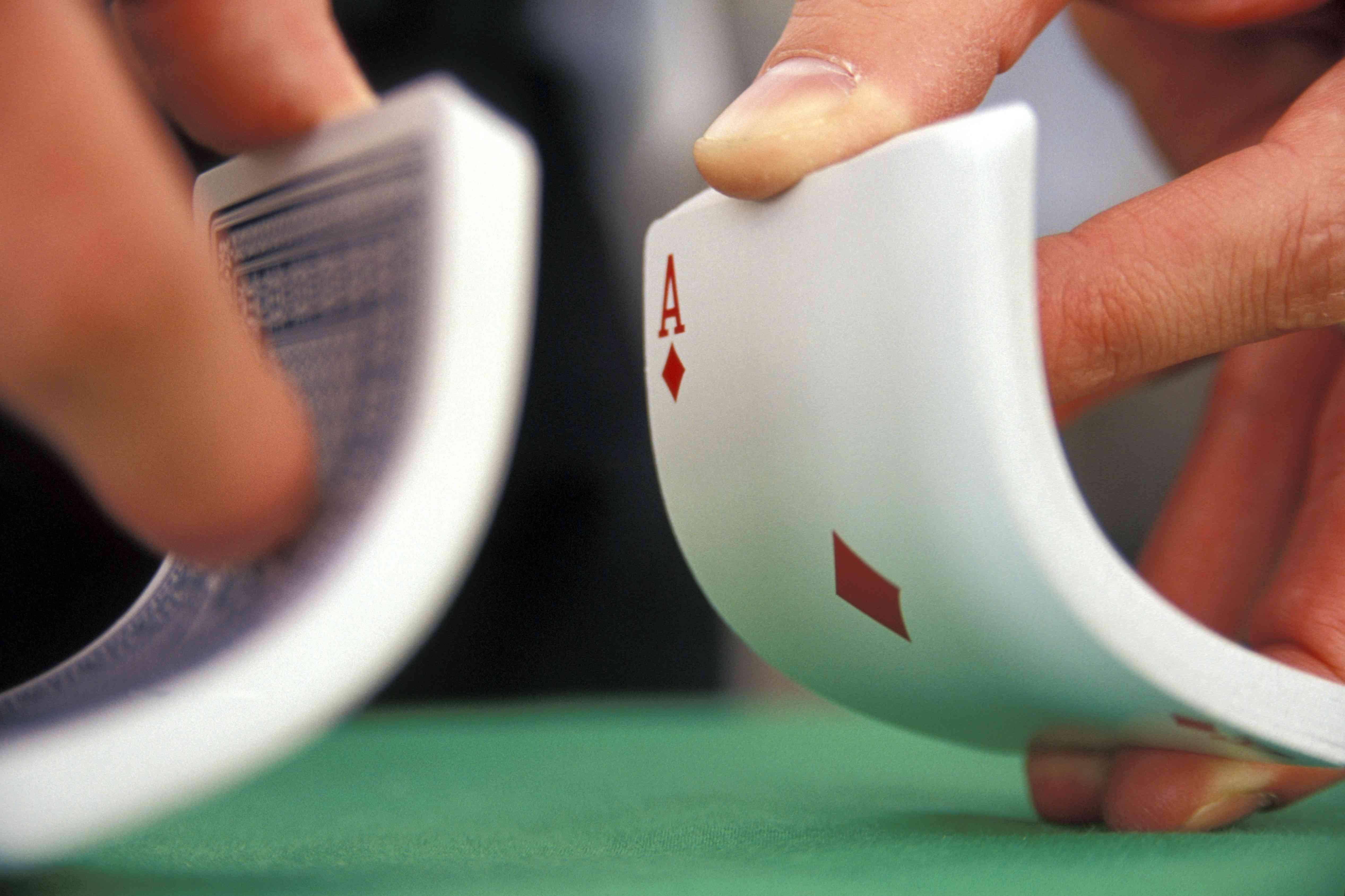 Bow the cards before as you're about to shuffle