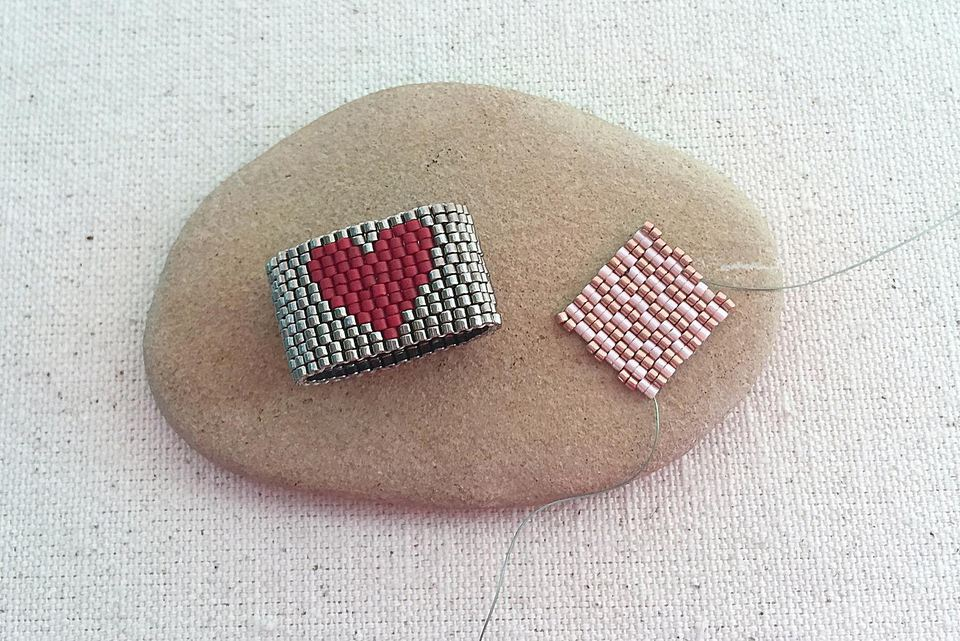 A ring and swatch both made with two drop peyote stitch