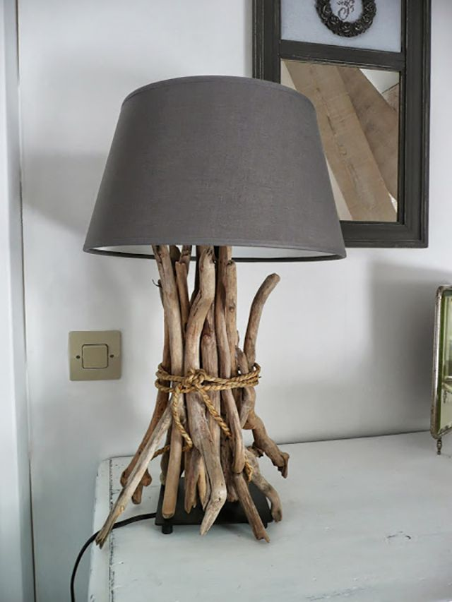 Driftwood tied together to form the neck of a table lamp.