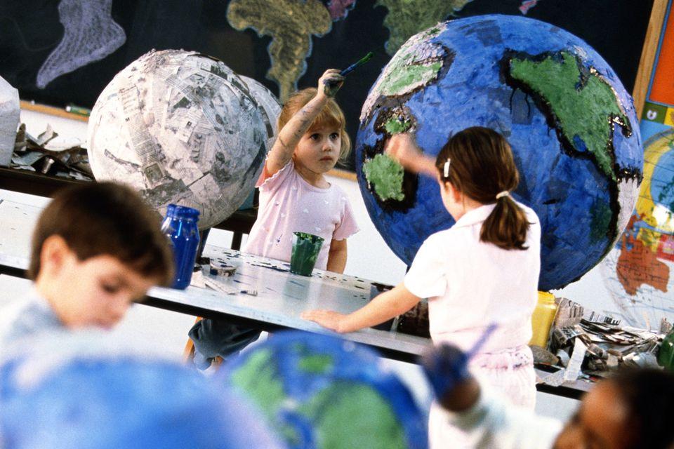 Children making paper mache globes