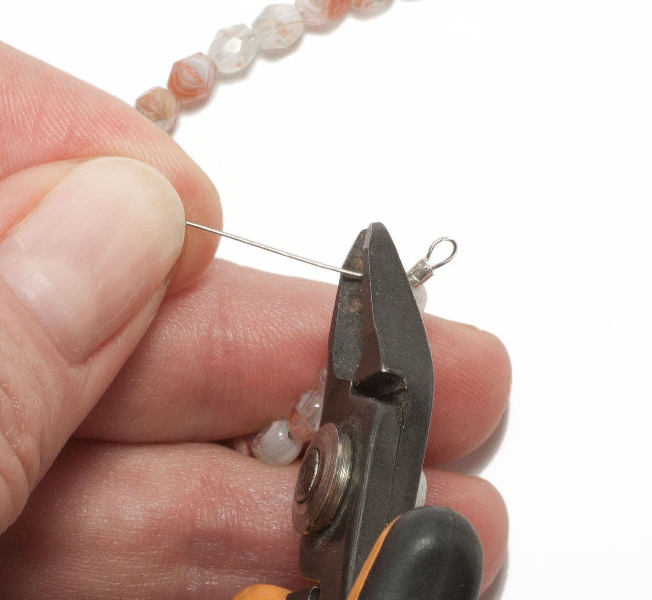 How To String Beads With Beading Wire Thread Read Wiring Diagrams Hands Trimming A Tail