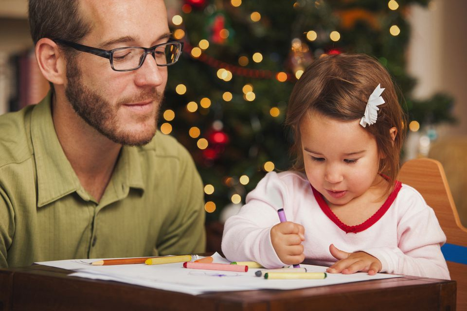 A young child coloring Santa coloring pages