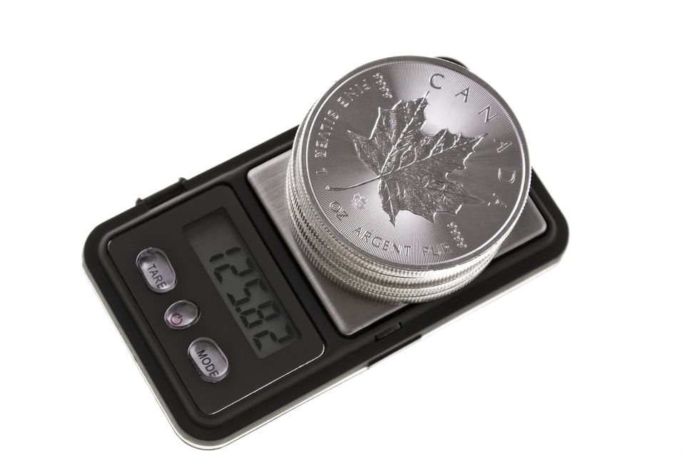 Silver bullion coins on a scale