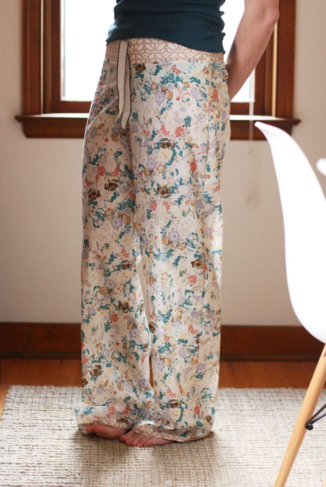 A woman wearing floral voile pajama pants