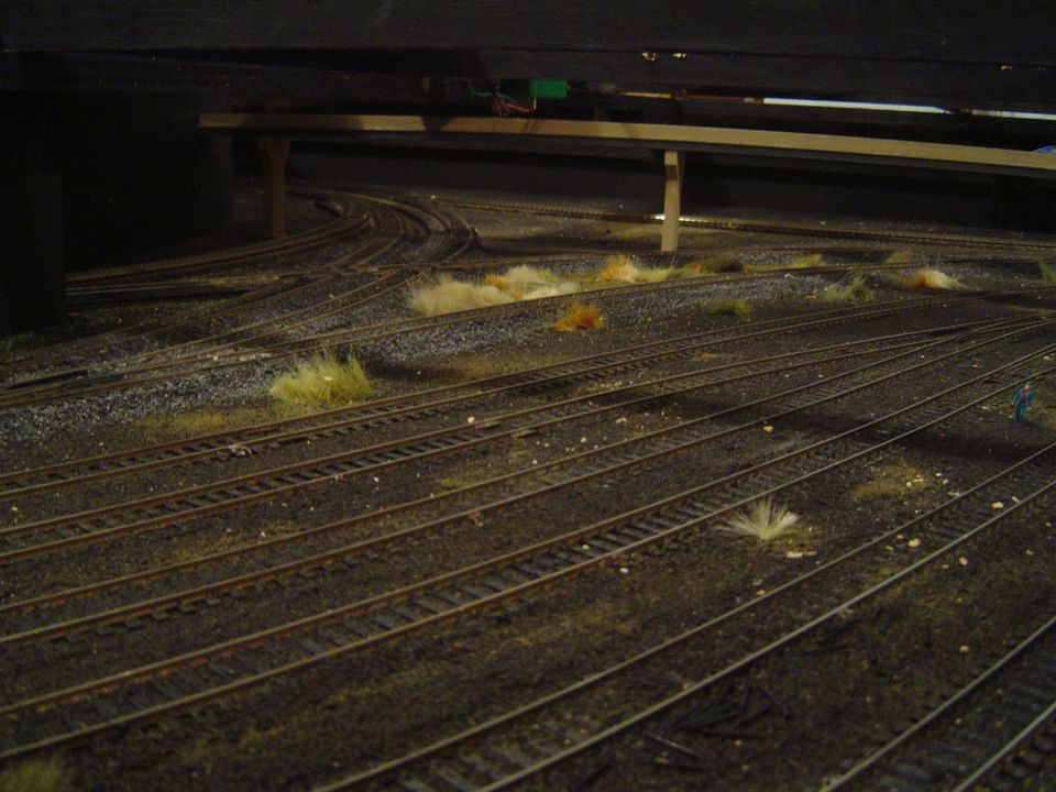 A painted and ballasted model track