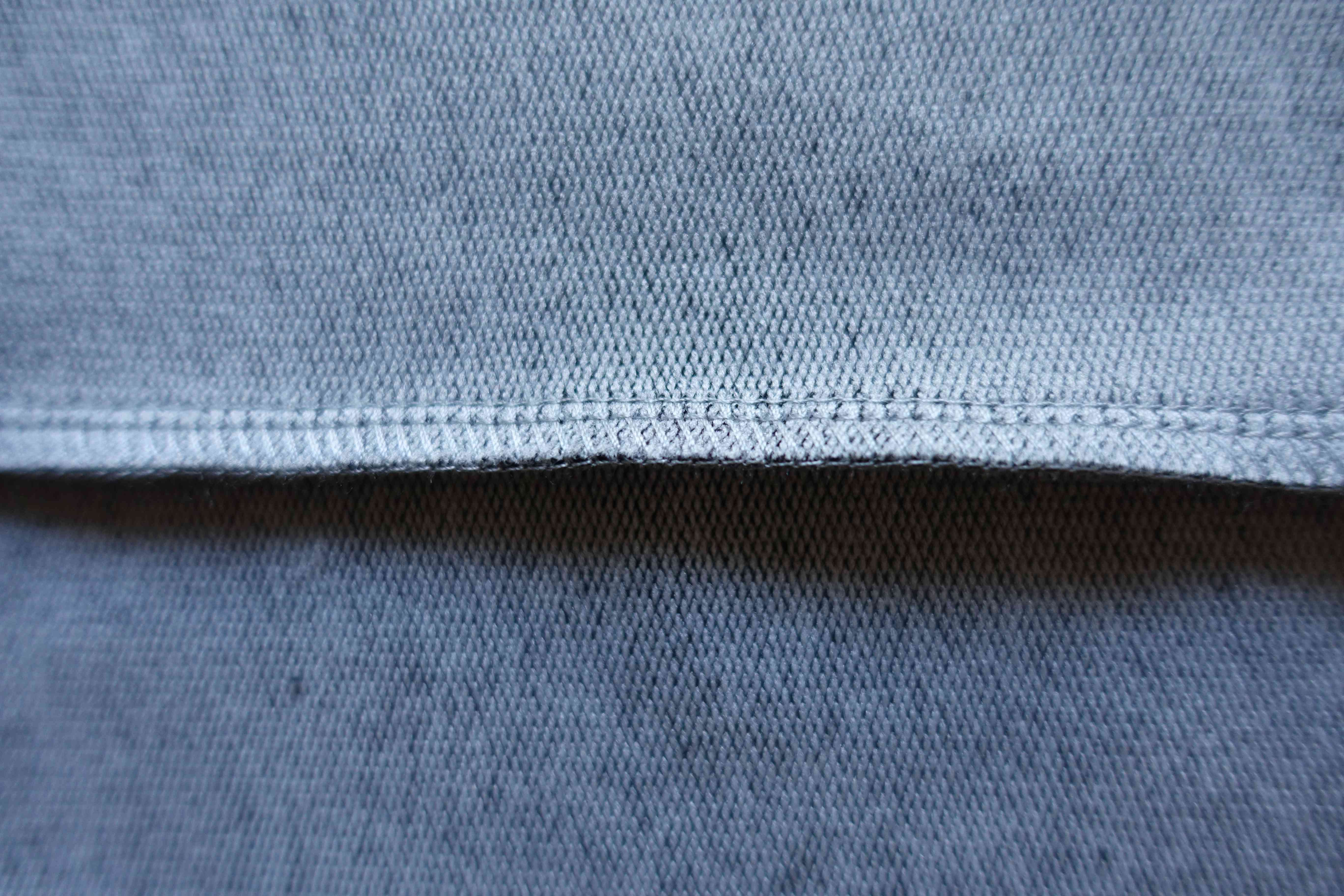 Stitch on the inner side of grey fabric