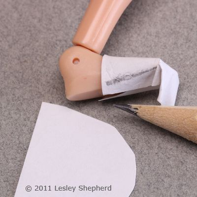 Mark a pattern for the toe of a doll's shoe.