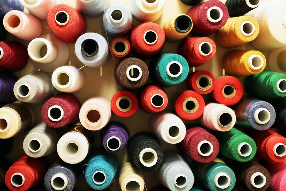 Wool, rayon and cotton thread spools