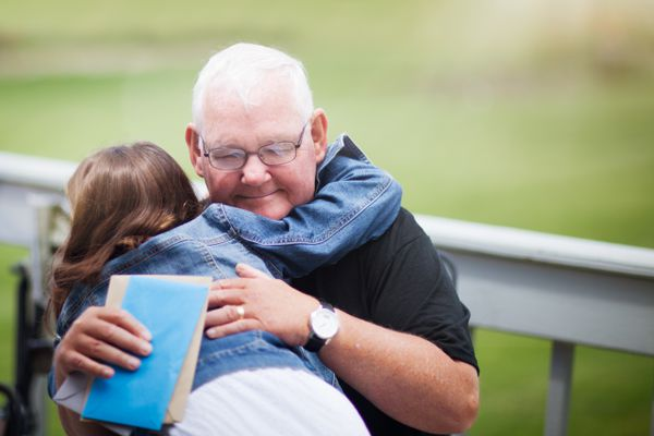 Grandfather and grandchild hugging