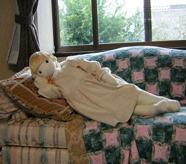 Doll laying on the sofa