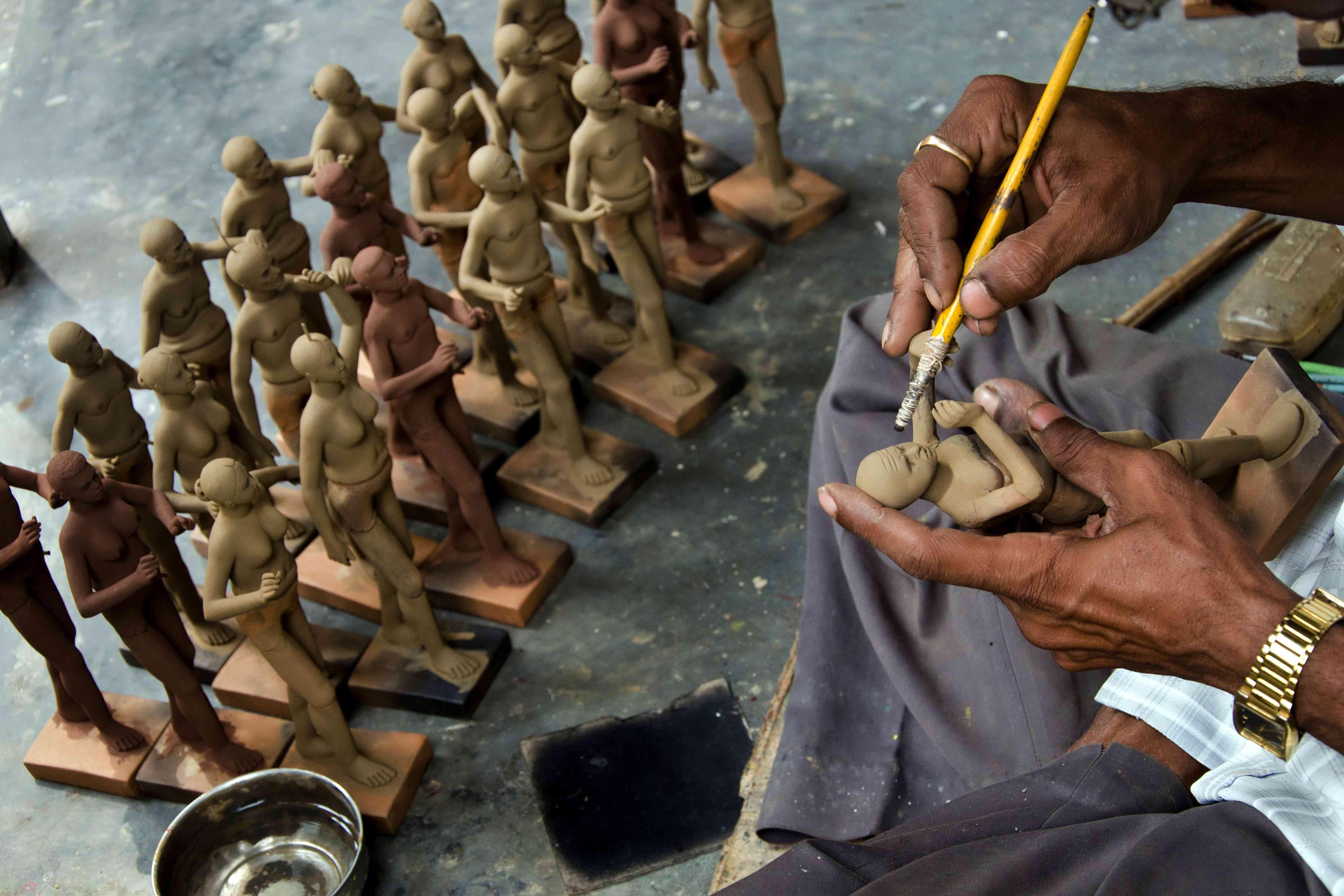 Man making clay dolls in Krisnanagar, West Bengal, India