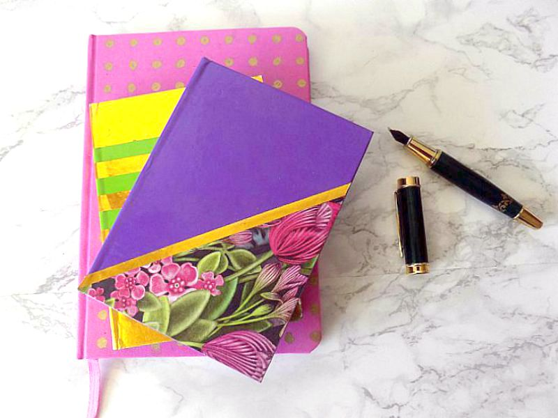 Purple and flower decorated notebooks