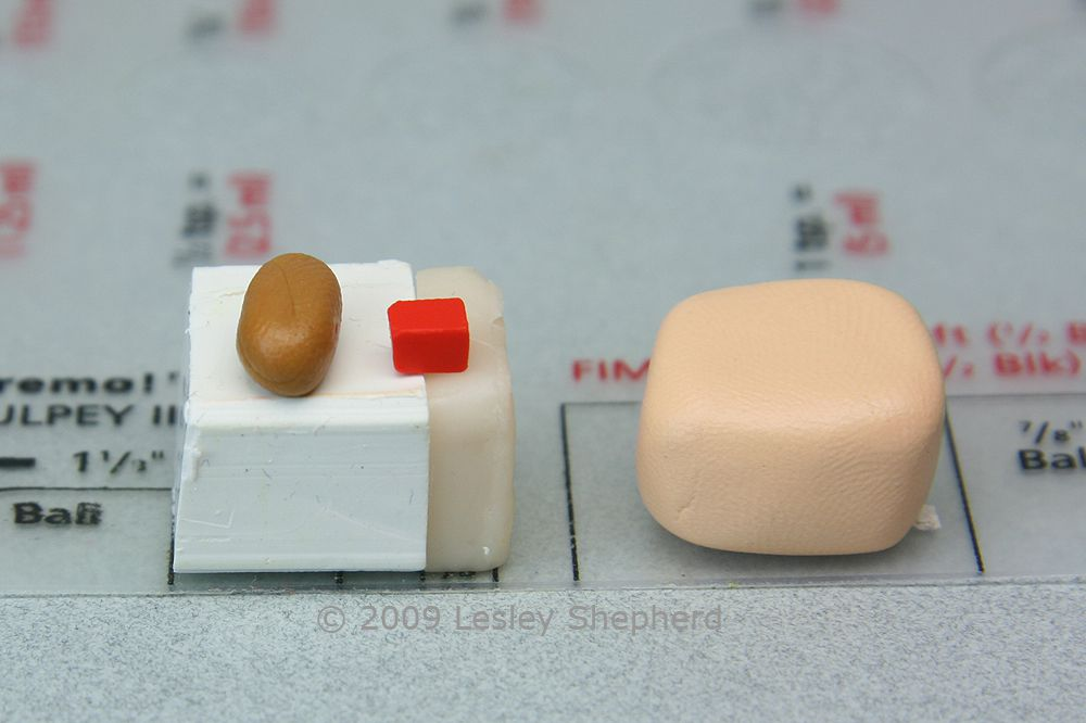White, translucent, ochre, and tiny amounts of red polymer clay used to make miniature bread dough