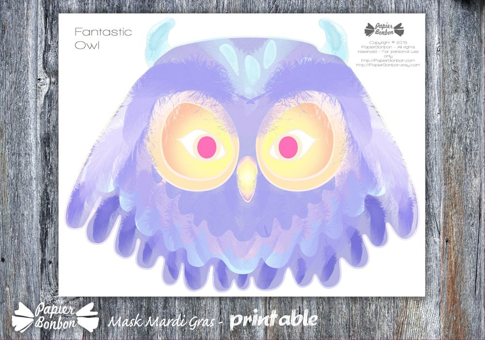 A purple and blue owl Mardi Gras mask.