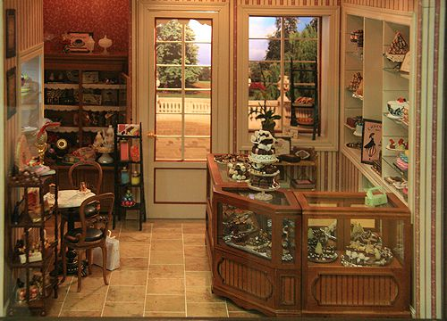 Pastry counters, displays, and a cozy table in a French Patisserie.