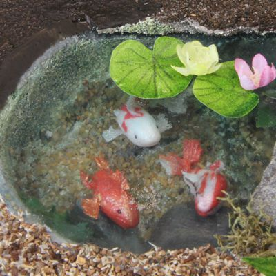 Scale 'fish food' on the water surface makes this simple dollhouse pond extremely realistic