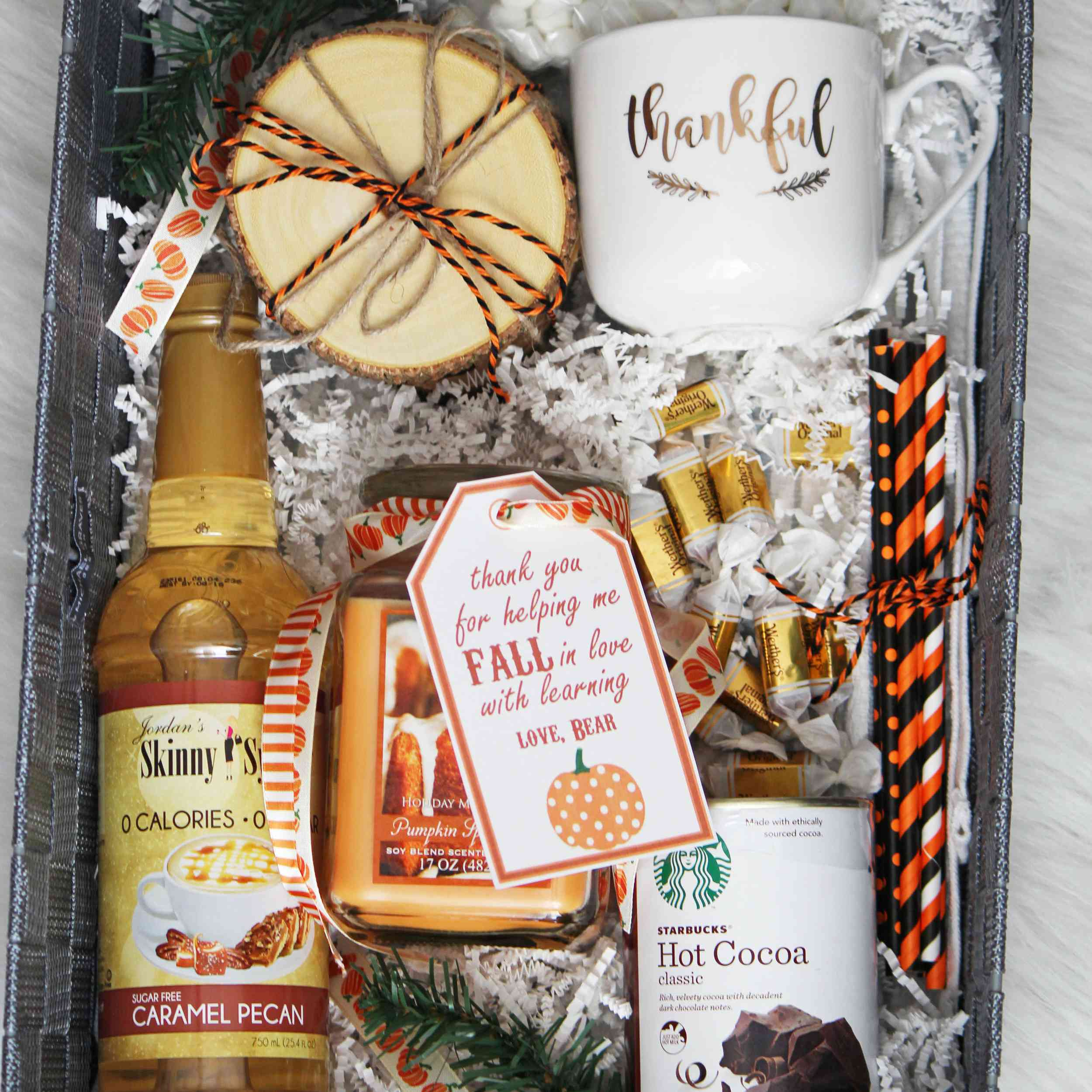 Fall-themed gift basket with cocoa and a cute mug.