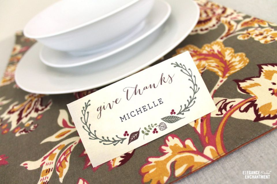 """A """"Give Thanks"""" place card by a table setting."""