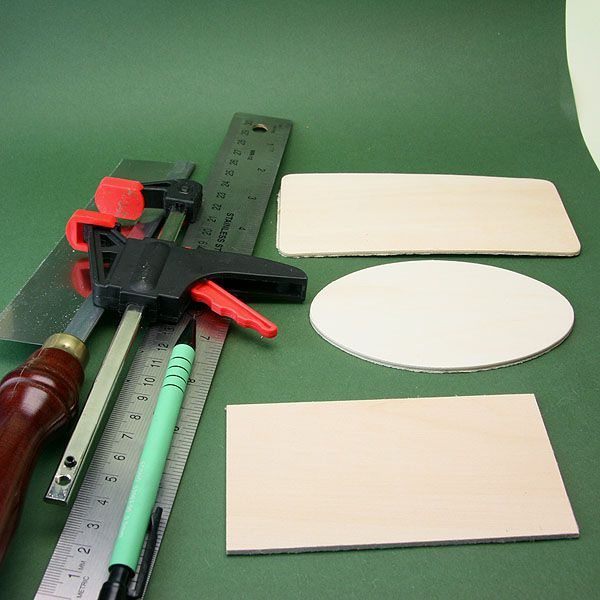 Saw, pencil, ruler, and pre-cut craft lumber shapes which can be used to make dollhouse scale table tops.