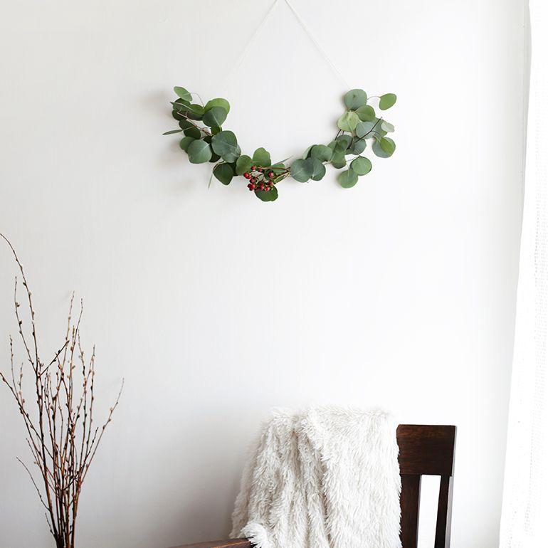 a minimalist wreath made with eucalyptus